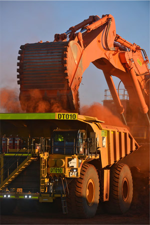 Roy Hill iron ore mine, haul truck loading iron ore