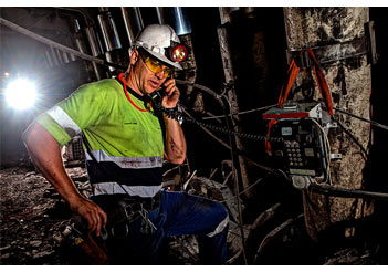 mining coal underground man supervisor on phone iMINCO Mining