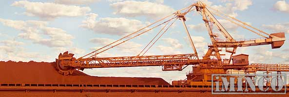 Roy Hill iron ore mine. Gina Reihnart, mining jobs creation. Image of an iron ore loader. iMINCO Mining Information.
