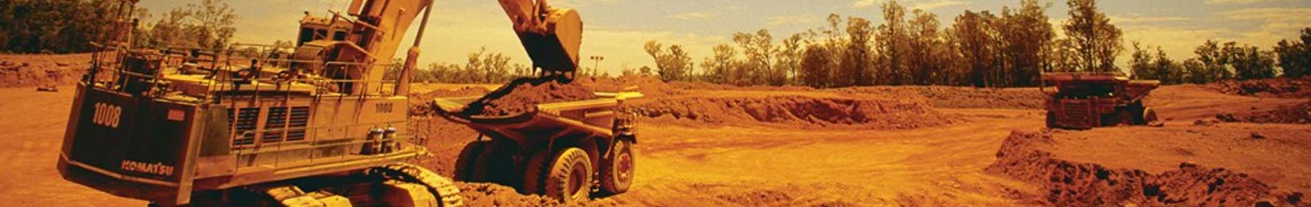 Mining iron ore dump truck and loader operations