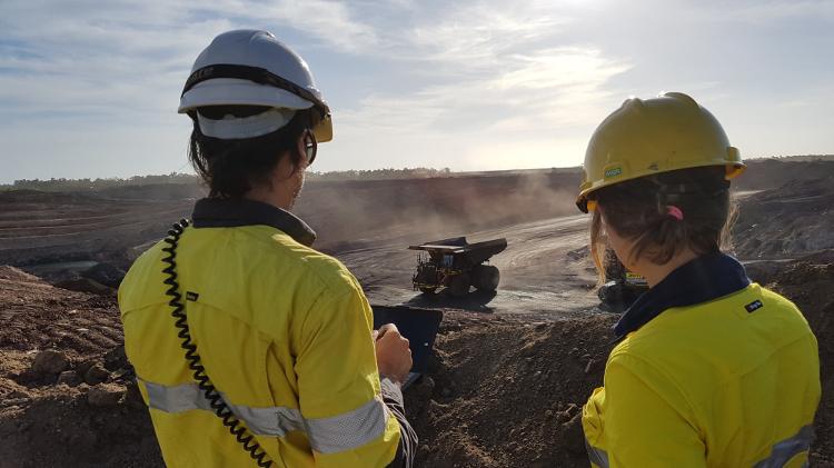 Women at mine site open cur