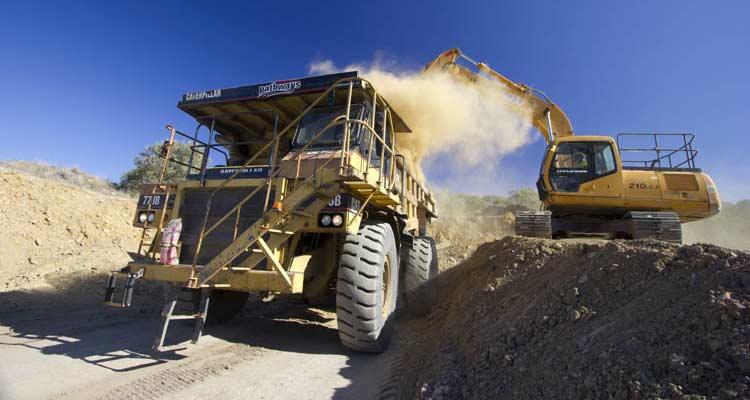 mining dump truck loaded CAT 773 Hitachi excavator